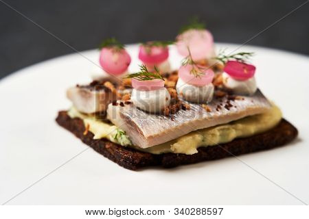 Smorrebrod With Baltic Herring Fish, Smoked Mousse And Pickled Onions