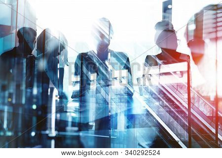 Background Concept With Business People Silhouette At Work. Double Exposure And Light Effects