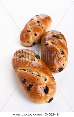 three buns with raisins