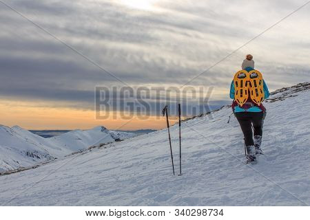 Girl With Backpack In The Mountains With Snow. Lifestyle Concept