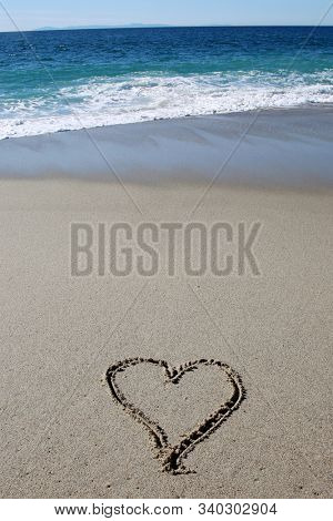 Love and Heart Shape written in sand. Words and Symbols written in the sand in Laguna Beach California.
