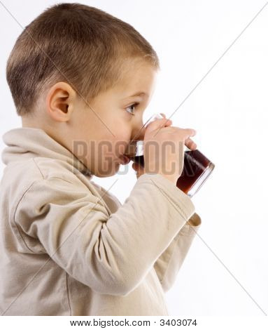 Boy holding a glass with both hands