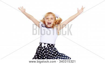 Cheerful Little Girl Short Skirt Polka Dot Jumps With Her Arms And Legs-isolated On White Background