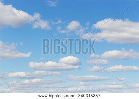 Cloudy Sky. Light Blue Sky With Puffy Cumulus Clouds, Heavenly Landscape. Background Wallpaper Backd