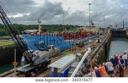 Panama-11/6/19: A View Of The Ship Maersk Corsica Going Throught The Panama Canal While Cruise Ship