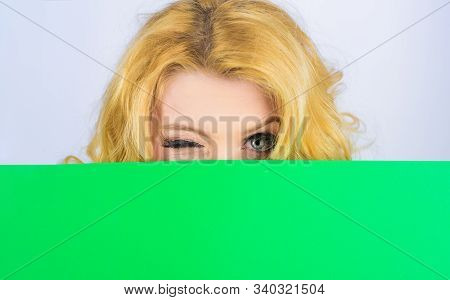 Winking Woman With Blank Billboard. Woman Hiding Behind Blank Sign Board. Advertising Banner. Blonde