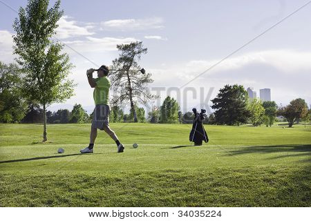 Man golfing at City Park, Denver