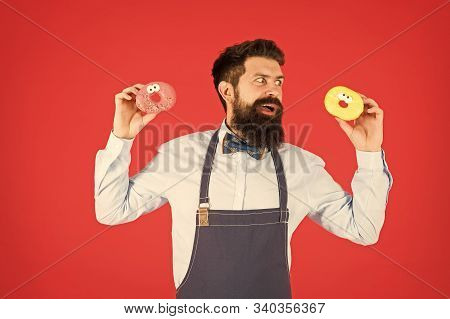 Glazed Donut. Bearded Well Groomed Man In Apron Selling Donuts. Donut Food. Baked Goods. Sweets And