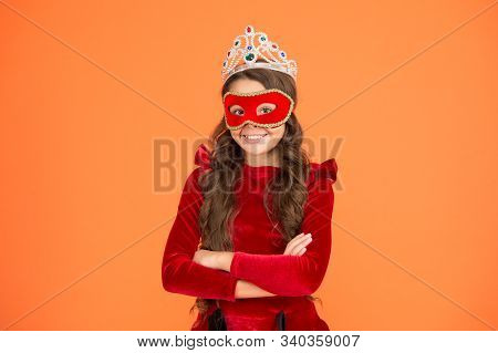 Royal and luxury. Visit royal public event anonymously. Winter new year party. Winter carnival. Incognito mode. Girl wear mask crown orange background. Royal event and entertainment. Princess award. poster