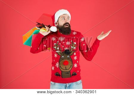 Guy Wear Knitted Sweater And Hat Carry Shopping Bags. Bearded Hipster Customer. Consumerism Concept.