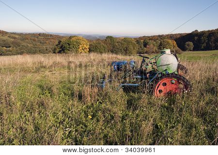 abandoned tractor in field