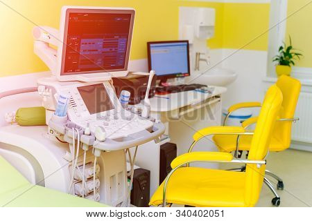 Interior Of Examination Room With Ultrasonography Machine In Hospital. Sonography. Health Tests Conc