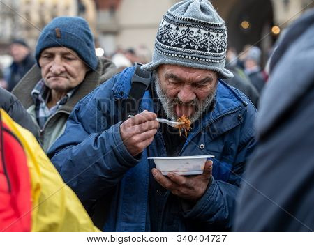 Cracow, Poland - December 15, 2019: Christmas Eve For Poor And Homeless On The Main Square In Cracow
