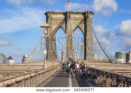 New York, Usa- Jul 9, 2010: Tourists And Residents Cross Brooklyn Bridge In New York City, New York.