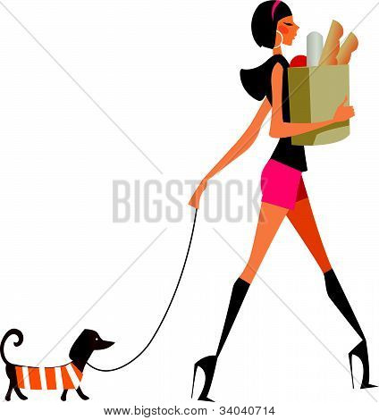 side view of woman walking with dog