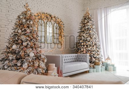 Beautiful Interior Of Living Room With Decorated Christmas Trees