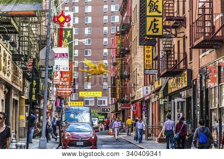 New York, Usa - Oct 5, 2017: Chinatown With Shops With Chinese Letters And Pegasus In Chinatown, New