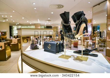 BERLIN, GERMANY - CIRCA SEPTEMBER, 2019: Jimmy Choo shoes on display at the Kaufhaus des Westens (KaDeWe) department store in Berlin.