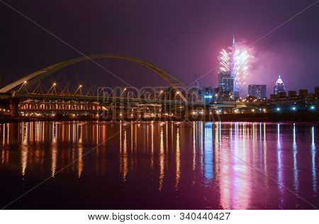 New Year Fireworks Light Up The Taipei City Skyline, Casting Reflections In The Keelung River