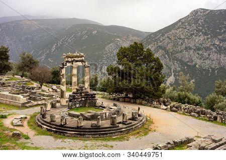 Tholos Of Delphi (athena Pronaia Temple) As One Of Many Ruins In Complex In Delphi, Greece With Slig
