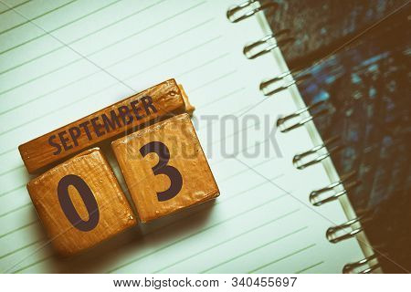 September 3rd. Day 3 Of Month, Handmade Wood Cube With Date Month And Day Placed On A Lined Notebook