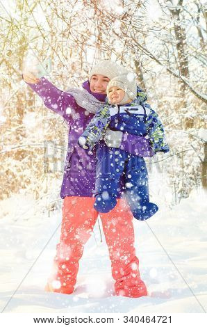 Mother And Baby Making Selfie In Winter Park