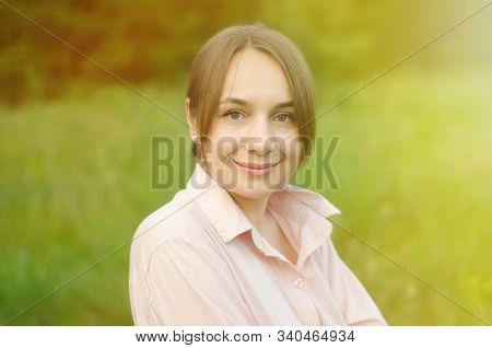 Beautiful Woman Portrait In The Green Field