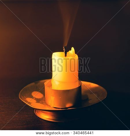 Extinct Candle On A Wooden Table At Night