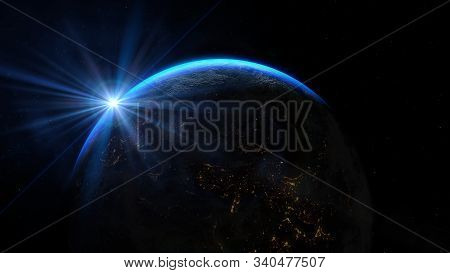 Planet Earth From The Space At Night. Sunrise Illuminate The Earth In Outer Space