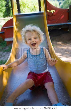 Cute Boy On A Slide