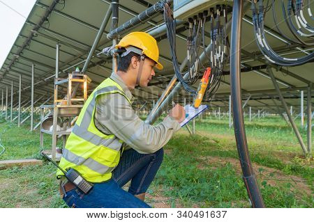 Portrait Of Engineer Man Or Worker, People, With Solar Panels Or Solar Cells On The Roof In Farm. Po