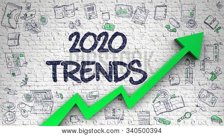 Brick Wall With 2020 Trends Inscription And Green Arrow. Business Concept. 2020 Trends - Development