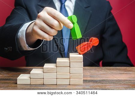 A Businessman Replaces An Employee With A New One On Career Ladder. Head Offset. Business Optimizati