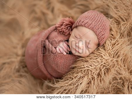 Charming newborn wrapped up in knitted blanket
