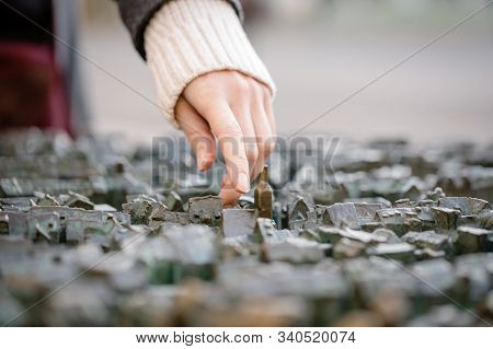 Model Of Old Town District Of Erfurt, Germany For Blind People. A Female Hand Touches