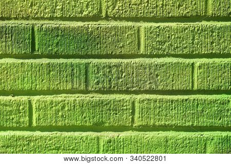 Mat brick wall paint in lime green with texture