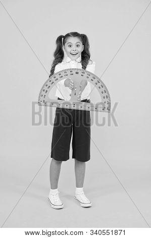 Engineering Course. Geometry Concept. Schoolgirl Holding Protractor For Lesson. Little Child Prepari