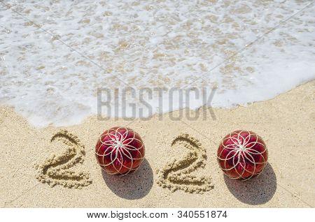 2020 Year Beach Background Near Ocean With Christmas Balls