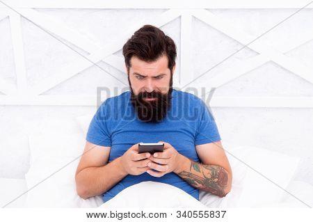 Sms Communication. Bearded Man Use Mobile Phone In Bed. Mobile Communication. Cellular Communication