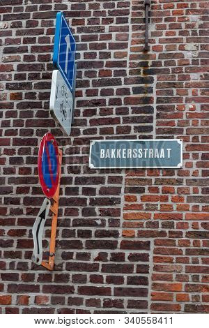 Bakkersstraat Sign On Brick Wall With Traffic Signs In Belgium