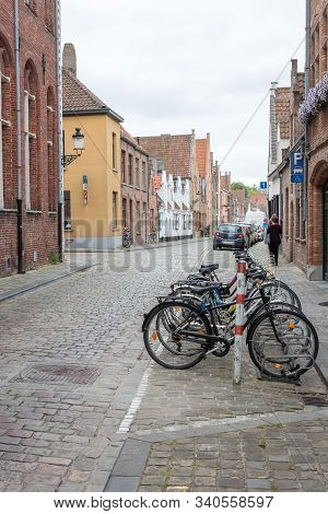 Row Of Bikes On Cobblestone Street In Bruges