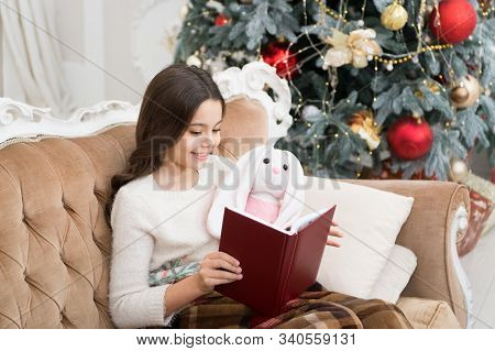 Reading Is Always A Good Idea. Little Girl Read Book To Toy Friend. Small Child Enjoy Reading Xmas S