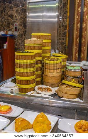 Hong Kong Dimsum Bamboo Steamer Boxes In Asian Restaurant