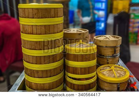 Pile Of Bamboo Dimsum Steamer Boxes In Chinese Restaurant