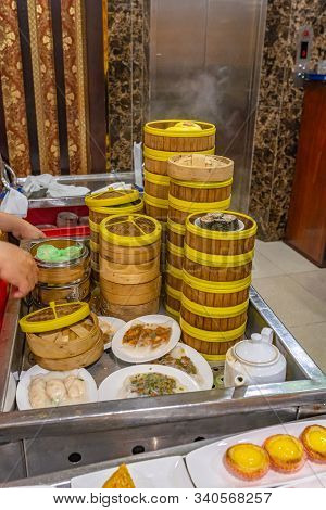 Assorted Dimsum Dumplings And Rolls In Chinese Bamboo Steamer Boxes