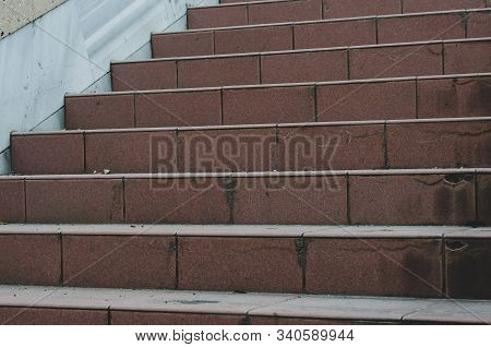 The Steps Of The Old Red Stairs. Dirty Steps Of A Wide Staircase. Staircase Outside The Residence. S