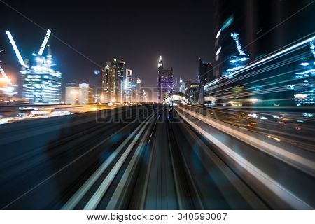 Tran running on rails in a night city., blurred motion with light.