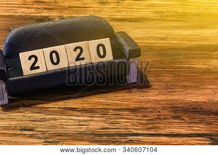 2020 Dice On The Miniature Sofa On White Background