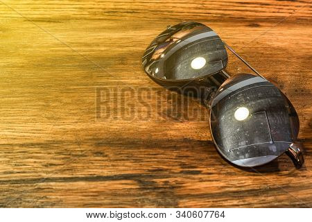 Single Simple Sun Glasses On The Wooden Table With Copy Space