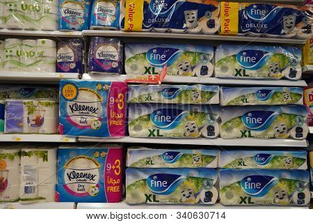 Bathroom Toilet Paper Tissue Packages Stacked Up. Various Types Of Branded Tissue Paper Packed Displ